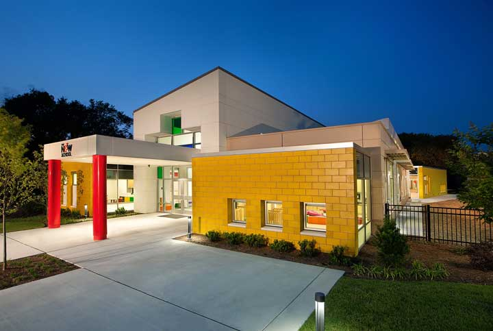 Exterior of The New E3 school at dusk
