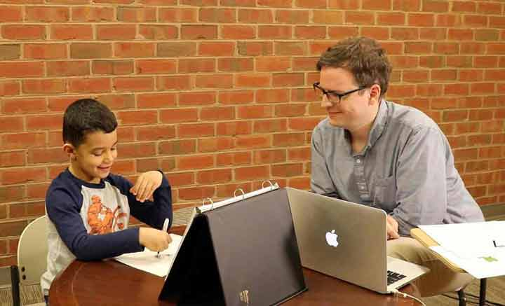 Teacher administering an progress-monitoring assessment